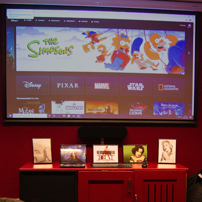 A photo of our cinema room. The programme menu is shown on the screen.
